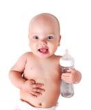 Bebé con la botella aislada imagen de archivo