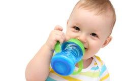 Bebé con la botella de leche Fotos de archivo