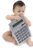 Bebé con la calculadora de bolsillo imagen de archivo libre de regalías