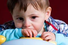 Bebé con la cara triste Imagen de archivo libre de regalías
