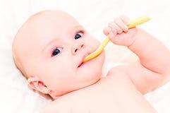 Bebé con la cuchara Fotografía de archivo