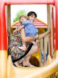 Bebé con la mama Foto de archivo