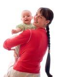 Bebé con la mama Fotografía de archivo