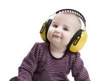 Bebé con la protección auditiva Fotos de archivo libres de regalías