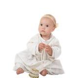 Bebé con las perlas Imágenes de archivo libres de regalías