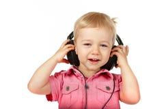 Bebé con los auriculares imagen de archivo