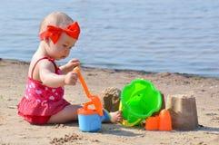 Bebé con los juguetes Imágenes de archivo libres de regalías