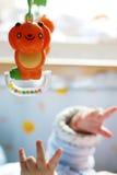 Bebé con los juguetes Foto de archivo libre de regalías