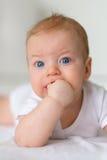 Bebé con los ojos azules Foto de archivo
