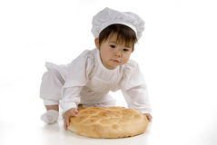 Bebé con pan Foto de archivo libre de regalías