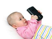 Bebé con PC del bolsillo fotografía de archivo libre de regalías