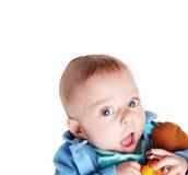 Bebé con su juguete fotos de archivo