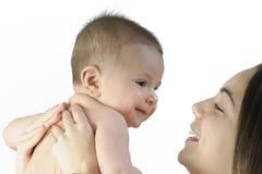 Bebé con su madre Foto de archivo