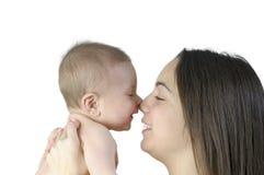 Bebé con su madre Imagen de archivo