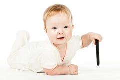 Bebé con teledirigido Imagen de archivo libre de regalías