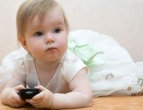 Bebé con teledirigido Imágenes de archivo libres de regalías