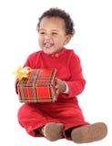 Bebé con un rectángulo de regalo Fotos de archivo