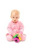 Bebé con una bola del color Imagen de archivo