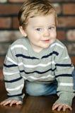 Bebé de arrastre feliz Foto de archivo libre de regalías
