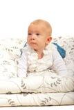 Bebé de arrastre que mira lejos Fotografía de archivo