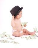 Bebé de Bisness con el dinero en el fondo blanco Imagen de archivo