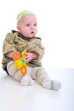 Bebé de la muchacha con el juguete anaranjado. Foto de archivo libre de regalías