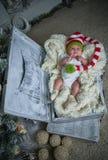 Bebé de la Navidad, el Año Nuevo, regalos, el árbol de navidad Fotografía de archivo libre de regalías