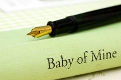 Bebé de la pluma del libro de la mina Imagen de archivo libre de regalías