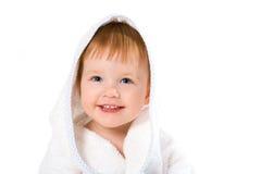 Bebé de la sonrisa de la belleza en toalla Fotos de archivo libres de regalías