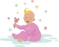 Bebé de risa con un juguete Imagen de archivo libre de regalías