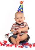 Bebé de sorriso feliz que comemora seu aniversário Fotos de Stock
