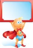 Bebé del superhéroe que lleva a cabo la muestra en blanco  Fotografía de archivo