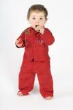 Bebé derecho que come el bizcocho tostado Foto de archivo