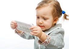 Bebé descontentado con el billete de banco Imagen de archivo libre de regalías