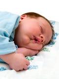 Bebé durmiente en blanco Imagen de archivo libre de regalías
