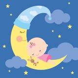 Bebé durmiente en la luna Fotos de archivo