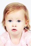 Bebé en alineada con los ojos brillantes Fotografía de archivo