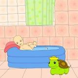 Bebé en baño fotos de archivo