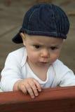Bebé en banco Fotos de archivo