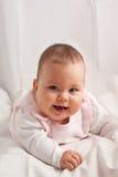 Bebé en blanco Fotos de archivo