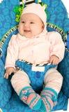 Bebé en butaca de los childs Imagen de archivo
