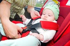 Bebé en coche Fotos de archivo libres de regalías