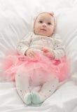 Bebé en color de rosa Fotos de archivo