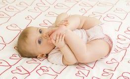Bebé en corazones Fotografía de archivo
