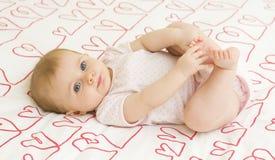 Bebé en corazones Fotografía de archivo libre de regalías