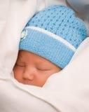 Bebé en coverlet Imagenes de archivo