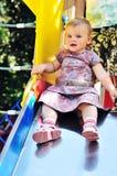 Bebé en diapositiva Imagen de archivo