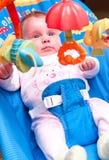 Bebé en eje de balancín Fotografía de archivo libre de regalías