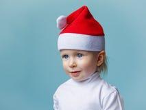 Bebé en el Año Nuevo 2015 del sombrero de Papá Noel Foto de archivo libre de regalías