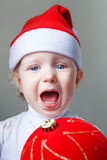 Bebé en el Año Nuevo 2015 del sombrero de Papá Noel Fotografía de archivo